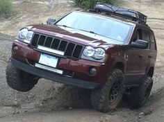 Savage's 2007 Jeep Grand Cherokee Limited with Interco Super Swamper tires on Interco Swamper wheels. 2005 Jeep Grand Cherokee, Jeep Wk, Truck Mods, Custom Jeep, Jeep Liberty, Jeep Life, Drag Racing, Dream Garage, American Jewelry
