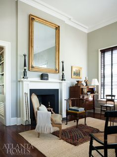 A large gilt mirror complies graciously with the scale of the formal living room at Redland, while a neutral color palette lends itself… Formal Living Rooms, Living Spaces, Greek Revival Architecture, Greek Revival Home, New Staircase, Blue Ceilings, Design Salon, Atlanta Homes, White Houses