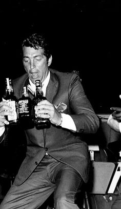 Dean Martin- even stylish men enjoy a drink or two. / AS1966