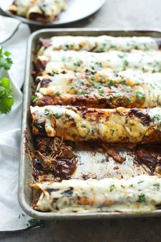 Shredded Beef Enchiladas with Ancho Chile Sauce – Cooking for Keeps Geschredderte Rindfleisch-Enchiladas mit Ancho Chile-Soße Mexican Dishes, Mexican Food Recipes, Dinner Recipes, Ethnic Recipes, Dinner Entrees, Shredded Beef Enchiladas, Good Food, Yummy Food, Comida Latina