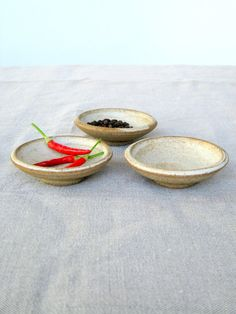 3 small rustic style, ceramic bowls. Great for serving spices, olives, dip or sauce.  Each bowl is one of a kind, handmade on the pottery wheel.  ✔