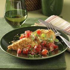 Bruschetta chicken - Yum! I used cracker crumbs instead of bread crumbs, seasoned diced tomatoes and a bit of mozzarella cheese on top.