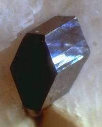 Babingtonite.Colour:	Dark greenish-black .	Hardness:	5½ - 6.Type Locality:	Arendal Iron Mines, Arendal, Aust-Agder, Norway.