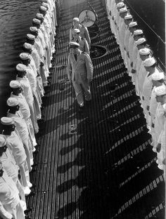 Inspection of neatly lined-up personnel aboard a US submarine at New London submarine base, 1943. By Edward Steichen