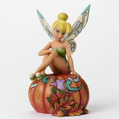"Autumn Tinker Bell This enchanting ""Pumpkin Pixie"" Tinker Bell perfectly posed for Autumn is a colorful combination Disney's magical character and the folk art style that is unmistakably Jim Shore. Tinkerbell And Friends, Peter Pan And Tinkerbell, Disney Fairies, Peter Pan Disney, Tinkerbell Disney, Disney Dream, Disney Love, Disney Magic, Disney Art"