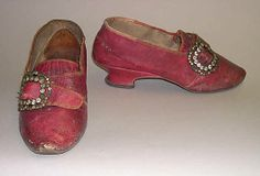 Slippers  Date:1770s  Culture: American or European  Medium: leather  Interesting to see the buckle placed to the side and not front and center as it is on most shoes in the 18thC
