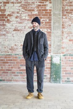 a black, heavy washed suit in Paul Hampton style