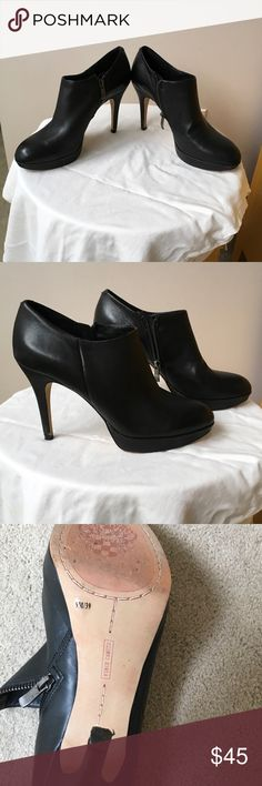 Vince Camuto black heal booties These are beautiful soft leather booties that are oddly comfortable! I wore them maybe 2 times and are in almost perfect condition. There is a very small nick on the right heal at the bottom (pictured). Size 9 true to size. Vince Camuto Shoes Ankle Boots & Booties