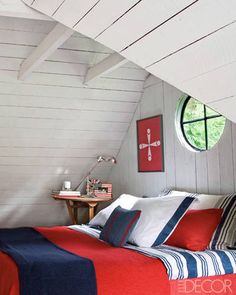 Belgian decorator Alex Flamant transformed this attic into a bedroom. Complete with whitewashed paneling and tricolor bedding & accessories, we dig the nautical feel. resibids.com