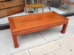 George Zee imported SOLID TEAK coffee table. Asian design, 1960's.   Teak coffee table measures 50 inches long 24 inches deep and 16 inches tall