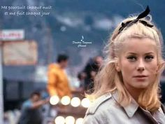 Catherine Deneuve on the set of The Umbrellas of Cherbourg, the 1964 musical film directed by Jacques Demy Catherine Deneuve, Jacques Demy, Compositor Musical, Umbrellas Of Cherbourg, Michel Legrand, French New Wave, Blu Ray, French Actress, Film Stills