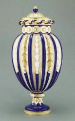 Vase  Sèvres Manufactory [French, active 1756 - present] Design attributed to Jean-Claude Duplessis père (designer) [French, about 1695 - 1774, active Sèvres, France 1745/1748 - 1774] Modeled by Michel-Dorothée Coudray [French, 1718 - 1775, active 1753 - 1774/1775] and possibly Roger père [active 1754 - 1784] Type: Decorative Arts Medium:   Soft paste porcelain, blue ground color, and gilding Place Created: Sèvres, France, Europe Date: about 1765 - 1770