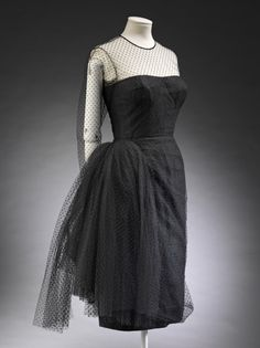 Dress  Madame Grès, 1955 black cocktail dress with sheer chest and arms - so cute!