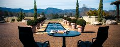 Just off Route 25 in upstate South Carolina, Hotel Domestique perches like a castle atop a hill cloaked by picturesque vineyards and surrounded by the majestic Blue Ridge Mountains.