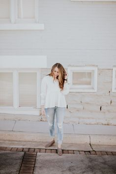 The perfect neutral and bright fall look. Love the textured top with the distressed jeans and booties.