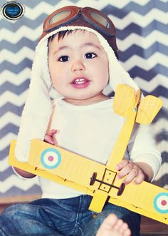 My son's first bday pictures I took. Vintage airplane. Nikon 50mm lens. 4.26.2013. Aviator hat Amazon.com, chevron background is a piece of fabric from Hobby Lobby. Vinyl floor is a scrap peice from flooring company.