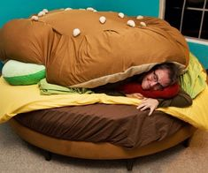 Sleep like <i>the</i> burger king with the hamburger bed that comes with your choice of toppings, soda, and a side of fries. Made using only the freshest ingredients, this delicious bed will wrap you up in between its lettuce and cheese, giving you a wonderful night's sleep.