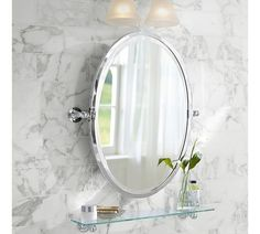 In the half bath, I like an oval mirror or recessed medicine cabinet above pedestal sink. Also like this double sconce above mirror.