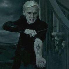 Draco reveling the Dark Mark