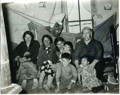 nōhkum Adeliene Half – holding Louise and her brother Peter sitting on the floor with a happy face, her aunt Elizabeth Large holding her cousin Martin Half and the Desjarlais cousins. Poetry Collection, Her Brother, Cousins, Aunt, Floor, Face, Happy, Faces, Ser Feliz
