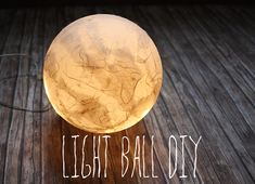 light ball diy - it's an acrylic ball with a hole in, full of fairy lights, then mache'd with pieces or 'kozo' paper, whatever that is?  Maybe like japanese screen door paper...