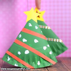Make a festive rocking paper plate Christmas tree craft, a nice little tree that can be placed on a table or a shelf as you really can't have too many Christmas trees! The post Rocking Paper Plate Christmas Tree Craft for Kids appeared first on Pinova. Paper Christmas Ornaments, Christmas Ornament Crafts, Diy Christmas Cards, Kids Christmas, Christmas Trees, Christmas Fonts, Christmas Nails, Preschool Christmas Crafts, Santa Crafts