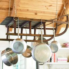 Have an old sled? Replace the pots and pans with Christmas garland, string lights and ornaments for a wintery chandelier! Like it for all year round? Use it as a way to hang your pots and pans for extra kitchen storage!