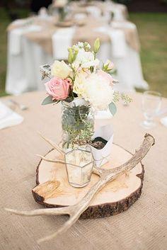 rustic wedding centerpiece with tree stump