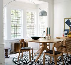 """The Cross Round Dining Table by Matthew Hilton is able to seat up to 8 people comfortably around the 1.5m (59"""") solid wood tabletop."""