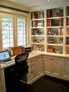 would love to have a home office like this with the shelves and cabinets too