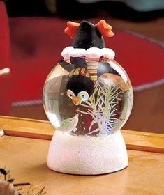 Add a touch of whimsy to your holiday decor with this Lighted Snow Globe. A familiar winter character looks like he is stuck half in and half out of the glitter- and water-filled globe. The sparkling base adds to the shine. Color-changing light insid
