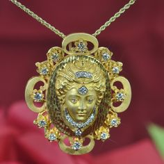 14K yellow gold Art Nouveau necklace featuring a goddess containing diamonds approximately 1.7 carats. Can be worn as a pendant and as a brooch. Weight: 28.4 gram/ 18.3 dwts
