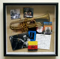 Great gift for a music lover! Take an old musical instrument, album covers, ticket stubs, sheet music & tie it all together in a custom shadow box.