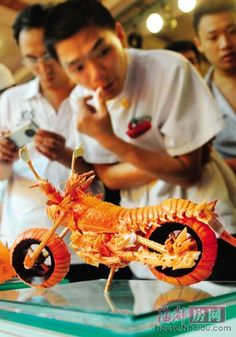Lobster Motorcycle Food Carving Design- I don't eat lobster, but this carving is amazing! I can't resist to pin it.