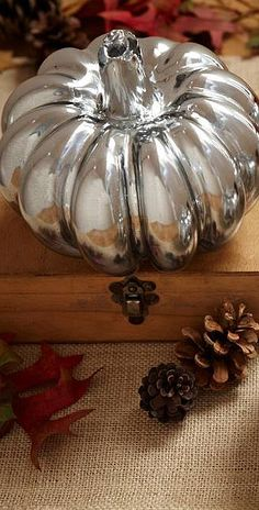 Spray paint pumpkins with mirror-finish paint for a quick and easy way to add glamour to your Halloween or fall decorating.