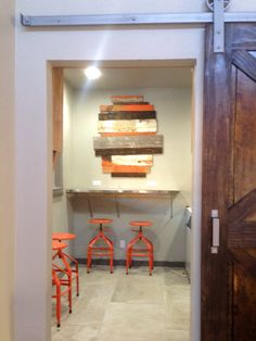 Used scrap wood, painted some orange, put up. All materials on site.