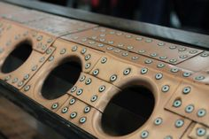 really amazing firewall and cowl on a hot rod that are covered with small riveted plates of what looks like brass. Pic 3