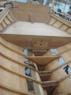"thepackardgoose: The ""Whiskey Plank"" remains on the Herreshoff Buzzards Bay-14 - - IMG_3394 by Northwest School of Wooden Boatbuilding on Flickr. Built over a couple of years; planked 2011. I'll get some pictures of the finished product up here sometime soon."
