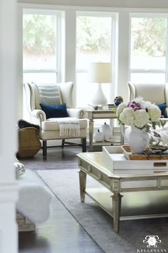living-room-with-pottery-barn-thatcher-wing-back-chairs-for-fall-with-navy
