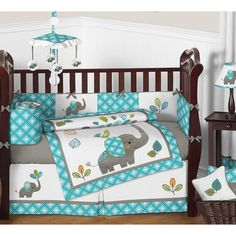 Mod Elephant 9 Piece Crib Bedding Set has all that your little bundle of joy will need. Let the little one in your home settle down to sleep in this incredible nursery set. This gender neutral crib bedding set features detailed appliqué and embroidery works of playful elephants. This collection uses the stylish colors of turquoise blue, teal, green, gray, orange, and white. The design uses cotton, microsuede, corduroy, and felt fabrics that are machine washable for easy care. This wonderful…
