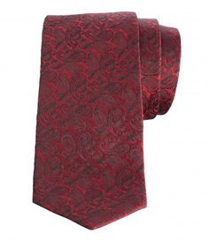 PAISLEY PATTERNED WOVEN TIE  When it comes to dapper patterns, paisley's hard to beat and this beautifully woven silk-tie from Stanza features the design in red.