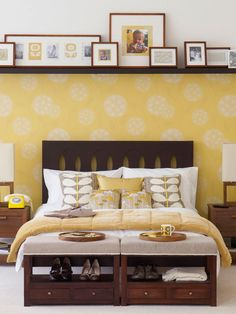 Photos and artwork look artful when displayed in matching frames on a long shelf above the bed -- #yellow #bedroomdecor