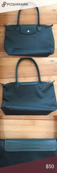 Authentic Longchamp Small Tote Modele Depose EUC Authentic Longchamp Small Tote. Not the folded medium or large version. This is modele depose model, the original model, not the folded type. Lovely bag. Has a tiny scratch on the back label as showed on the 3rd picture. No other flaws to note. NO TRADES, cheaper through PayPal or mercari Longchamp Bags Shoulder Bags