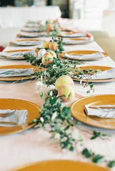 Peach and green garland table runner at The Farmhouse in Ellerslie, Georgia. MyLife Photography. More: http://www.theknot.com/weddings/album/an-elegant-rustic-wedding-at-the-farmhouse-in-ellerslie-georgia-171936