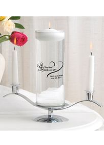 """A modern twist on an old tradition, this Floating Unity Candle Set is more than just a candle. It's also a pretty personalized vase that can be used again and again, the perfect way to remember that special day for years to come. This unique addition to the wedding ceremony comes complete with personalized vase, white floating candle (burns approximately 10 hours), stand and two 6"""" white tapers (burns approximately 6 hours), and is offered in a variety of attractive designs. Measures 9"""" x 3…"""