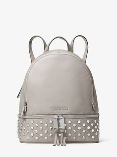 Sleek silver-tone faceted embellishments punctuate our Rhea backpack with  edgy personality. This modern leather carryall features two main zip  compartments ... 4da0bd5356