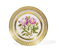 A Russian porcelain plate, Yusupov workshop, Arkhangelskoe, 1827, the cavetto with a rose blossom after a design by Pierre-Joseph Redouté, the border with a continuous stylized foliate wreath, inscribed in gilt letters Rosier de la Reine Elisabeth at the base of the cavetto and on the reverse, also in gilt letters Archangelski 1827 and Tome 2 p 1.