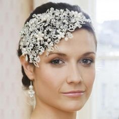The ultimate 1920's vintage style headdress heavily woven with luxurious detail. Pearls, Swarovski crystals, silver lined glass and moonstone laced into tendrils, leaves and floral details. Sits close to the head and sweeps elegantly across the edge of the forehead. Can be made to fit either side of the head.