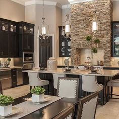 Transitional Kitchen, with brick accent range hood. Transitional Kitchen, with brick accent range hood. New Kitchen, Kitchen Dining, Kitchen Decor, Kitchen Ideas, Kitchen Layout, Kitchen Pantry, Kitchen Interior, Dark Cabinet Kitchen, Kitchens With Dark Cabinets