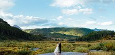 Ceremony site outside near water, surrounded by the beauty of the Colorado mountains